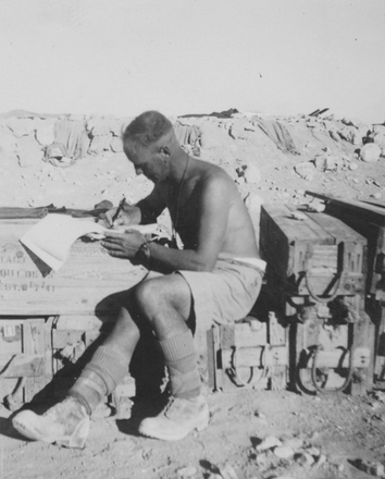 Photograph of Private Philip (Phil) Kent writing home from the Western Desert. From the collection of Arthur William (Moss) Squire 16770, 23 Battalion. Image kindly provided by Roger Sommerville (August 2019). Image may be subject to copyright restrictions.
