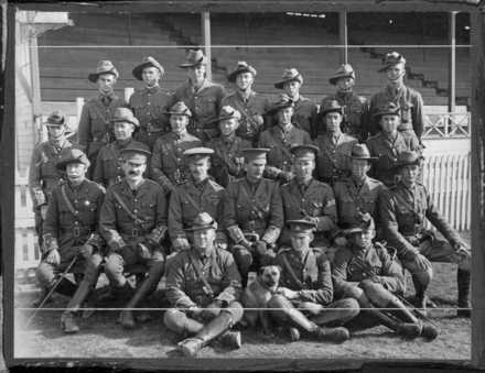 "Officers of the Canterbury Mounted Rifles at Addington Camp, Christchurch, August 1914. Back row: Lieutenants L Chaytor, Taylor, Barker, W Deans, F Gorton, Hayter, D S Murchison. Second row: Lieutenant Marchant, Captain Talbot, Lieutenant Blackett, Captain Hurst, Captain Hammond, Lieutenant Free, Lieutenant Bruce. Sitting: Major Wain (O.C. 8th Sqd.), Captain Cody (Q.M.), Major Overton (2nd in Command), Lieutenant-Colonel Findlay (C.O.), Captain Blair (Adjutant), Major Acton-Adams (O.C. 1st Sqd.), Major Hutton (O.C. 10th Sqd.). Front row: Lieutenant Gibbs (Signalling Officer), Tommy the mascot, Lieutenant Davison (Machine Gun Officer), Lieutenant G Dailey. Publication note - Published in ""The History of the Canterbury Mounted Rifles 1914-1919"" edited by C G Powles, 1928 Quantity: 1 b&w original photographic print(s). Physical Description: Silver gelatin print 15.5 x 20.4 cm. Officers of the Canterbury Mounted Rifles, Addington Camp, Christchurch. Powles family :Photographs. Ref: PAColl-5268-2-01. Alexander Turnbull Library, Wellington, New Zealand. /records/22690564"