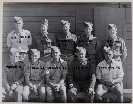Back row (l-r): E. K. Whitechurch, M. J. S. Hutt, J. S. Waikea, C. R. Becroft, R. H. Embling, Front row (l-r): A. Young, G. G. Smaill, R. L. Werner, A. E. Young, E. S. Snowden. Indentification Album RNZAF (c.1939-1945). Aerodrome Defence Unit, Camp 1. Hibiscus Coast (Silverdale) RSA Museum (G146). CC BY 4.0.