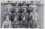 Back row (l-r): W. G. Jenkins, A. C. Burnie, W. B. Le Grys?, E. K. Whitechurch, Middle row (l-r): C. E. Shanks, F. C. Schroder, N. F. Coster, D. R. Sadgrove, Front row (l-r):  N. C. C. McKay, N. W. Johnson, K. E. Amohanga, A. M. Trevarthen. Identification Album RNZAF (c.1939-1945). Aerodrome Defence Unit, Camp 1. Hibiscus Coast (Silverdale) RSA Museum (G62). CC BY 4.0.