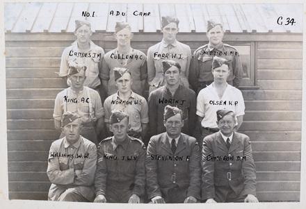 Back row (l-r): J. M. Gaddes, A. C. Cullen, W. I. Farr, M. D. Sneddon, Middle row (l-r): A. C. King, W. S. Norman, J. Worth, K. P. Olsen, Front row (l-r): W. W. Williams, F. Stevenson, D. M. Cameron. Identification Album RNZAF (c.1939-1945). Aerodrome Defence Unit, Camp 1. Hibiscus Coast (Silverdale) RSA Museum (G34). CC BY 4.0.
