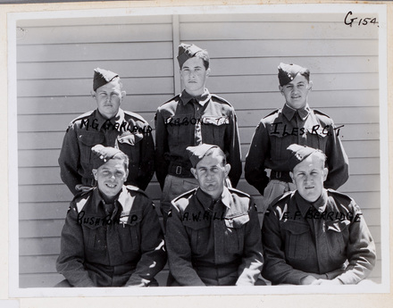 Back row (l-r): M. G. Garland, T. R. Rabone, R. G. T. Iles, Front row (l-r): P. Rushton, A. W. Hill, E. F. Berridge. Identification Album RNZAF (c.1939-1945). Aerodrome Defence Unit, Camp 1. Hibiscus Coast (Silverdale) RSA Museum (G154). CC BY 4.0.