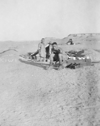 Photograph of Roy Beatson at 'Kiwi House' with Arthur Moss in the background, Western Desert, c.July to August,1941. From the collection of Arthur William (Moss) Squire 16770, 23 Battalion. Image kindly provided by Roger Sommerville (September 2019). Image may be subject to copyright restrictions.