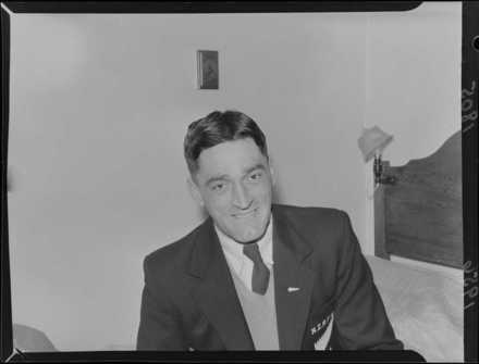 Photograph of Stanley Frank (Tiny) Hill, All Black, 25 August 1956. Served in Jayforce and in the Vietnam War. Photograph taken for the Evening Post newspaper of Wellington by an unidentified staff photographer. Alexander Turnbull Library, Wellington, EP/1956/1805-F. Image is subject to copyright restrictions.