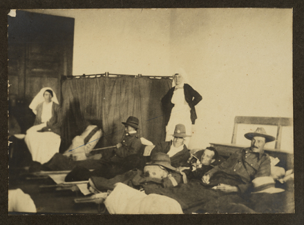 Photographs of patients in the Receiving Room, 27th General Hospital, Cairo, [1]7 March 1917, 'Leaving for New Zealand'. Pictures (from left to right) 'Sister ___' (unidentified), 'Tuakeo' (Tuakeo Terongo 19327), 'Sister Monk' (unidentified), 'Self' (David Hunter Palmer 13/593), 'Jerry Spooner' (Gerard Edmund Spooner 11/1060), and 'Alan Blackie' (Allan Stewart Blackie 13/878). Image kindly provided by Stanley Palmer (October 2019). Image has no known copyright restrictions.