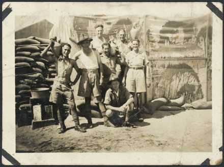 Photograph of 'Jim Vernon and others at Cairo'. Includes Ken Williams, Dick Russell, Doug Fereband, Carl Head, Bob Howarth, Jim Vernon, Maynard McKay, taken at Maadi Base Camp, c.February to April 1941. Photographer unknown. Alexander Turnbull Library, Wellington, PA1-o-1522-05. Image is subject to copyright restrictions.