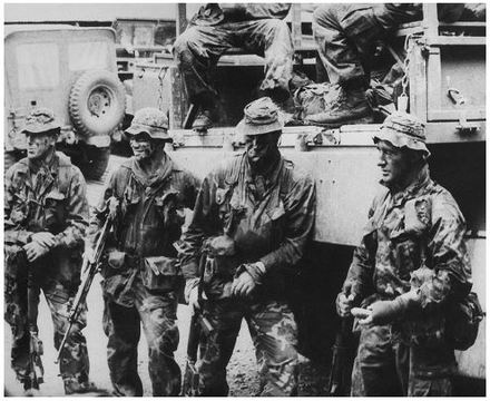 Bret Bestic, Norm Kuotua, Trevor Sexton, Ernie Stead after SAS patrol, left to right: Bret Bestic, Norm Kotua, Trevor Sexton, Ernie Stead. Image kindly provided by Bret Bestic (October 2019). Image may be subject to copyright restrictions.