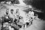 Photograph of Thomas Alfred Mann 13740, James (Jim) Hennessy, James (Jim) Slaven and Major Alfred Carswell Marett 13740 at lunch near Tripoli. From the collection of Arthur William (Moss) Squire 16770, 23 Battalion. Image kindly provided by Roger Sommerville (December 2019). Image may be subject to copyright restrictions.