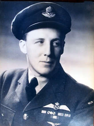Portrait of RNZAF Wing Commander Thomas Welch Horton who served with No. 105 Squadron RAF during World War II. Portrait taken during an investiture ceremony in 1945 at the Court at Saint James's. Image provided courtesy of W/C Horton and Dave Homewood of Wings Over New Zealand. Public Domain.