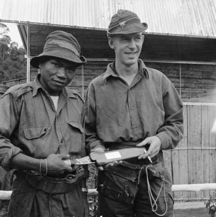 Photograph of Uda with Lieutenant Ian Hamilton Burrows, Malaya, c.1955. Taken by an unknown New Zealand Army photographer. Alexander Turnbull Library, Wellington, M-0766-F. Image is subject to copyright restrictions.