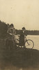 Photograph of Nurse Margaret Nixon and Nurse Eleanor Gould with bikes on the banks of the river. From Nurse Gould's Photo album. Image kindly provided by National Army Museum 1986.1753. Image may be subject to copyright restrictions.