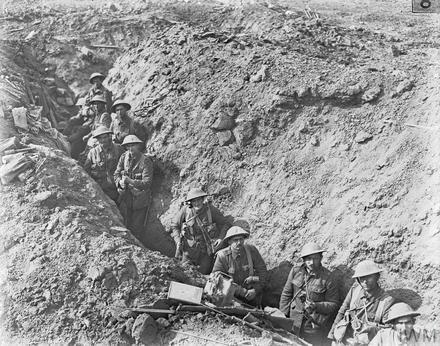 The Battle of Flers Courcelette 15 -22 September: Men of the 2nd Auckland Battalion (New Zealand) in a switch trench near Flers. Imperial War Museum Q194. The soldiers are identified as follows, from bottom right to top left. Number soldiers right to left. With soldier lower right as number 1. Middle is number 5. High Left is 10. 1. Private Henry James Gluyas (9/2173); 2. Lieutenant Henry Holman Hayhurst (11/1761); 3. Officer Commanding Captain John Bertrand Parks (10/90); 4. Sergeant George Watson Clark (9/550); 5. Lance Corporal Douglas Rawei McLean (6/1917); 6. Private Thomas Lindsay Hazleton (6/3035); 7. Sergeant Ernest Carr (6/754); 8. Private Cyril John Dugdale (7/1737); 9. Corporal Neil McKenzie McQueen (6/1920);10. Private Gorge Harry Coup (6/3667)