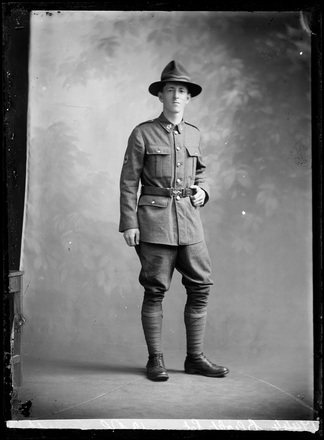 Crown Studios, Auckland. Studio portrait of a soldier. Collar badge and Red Cross cloth arm badge denote the Medical Corps. Name from glass plate inscription: Blight. See also 7003-536. Historical note: William Thomas Blight. Service No. 3/3145. Private. NZEF 27th Reinforcements (First Draft) New Zealand Medical Corps. (Source: Auckland War Memorial Museum, Cenotaph record). Auckland Libraries Heritage Collections 7003-283. No known copyright restrictions