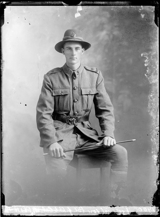 Crown Studios, Auckland. Studio portrait of a soldier. Hat and collar badges denote the New Zealand Rifle Brigade. Name from glass plate inscription possibly Private J. B. Fredrickson?. Auckland Libraries Heritage Collections 7003-284. No known copyright restrictions