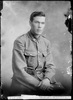 Crown Studios, Auckland. Studio portrait of a soldier. Collar badges denote NZEF 21st Reinforcements. Name from glass plate inscription: Private G. A. McDonald. Historical note: George Aaron McDonald. Service No. 33577. Private. NZEF 21st Reinforcements E Company. (Source: Auckland War Memorial Museum, Cenotaph record). Auckland Libraries Heritage Collections 7003-296. No known copyright restrictions