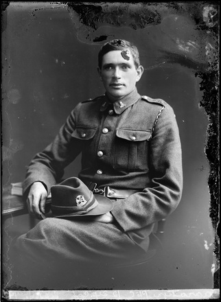Crown Studios, Auckland. Studio portrait of an unidentified soldier. Hat and collar badges denote NZEF Infantry 23rd Reinforcements. Name from glass plate inscription possibly C Bannatyne. Auckland Libraries Heritage Collections 7003-339. No known copyright restrictions