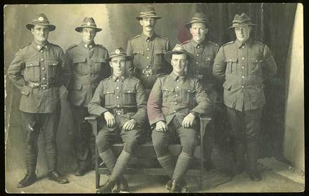 Group portrait of Mackenzie County soldiers, c.1917. Back row, from left to right: Lance Corporal Arthur George Curtis, Private William Maylen, Private Robert Nelson, Private William Hugh Corbett, Private Adam Corbett. Front row: Rifleman Richard Casey and Private Thomas Nelson. All were from the Cave-Albury-Cricklewood area of the Mackenzie County. Photograph was likely taken in England as most embarked in June 1917 except Robert Nelson who embarked in October. The Nelsons and Corbetts were brothers. Image courtesy of P. Bishop, SCRoll Project, South Canterbury Museum. Image is subject to copyright restrictions.