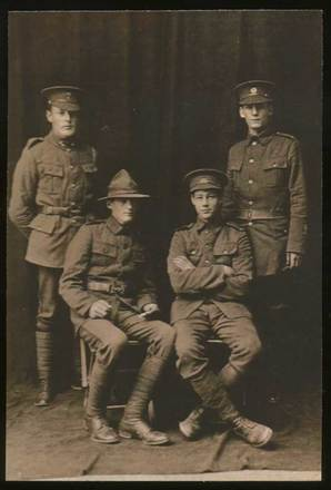 Group portrait of Daniel O'Shea (seated, right) with three unidentified soldiers, c.1915. Image courtesy of P. Buchanan, South Canterbury Museum. L2013/008.01. Image is subject to copyright restrictions.