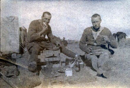 Photograph of 'Wynton French (left) and a friend enjoy Christmas dinner at Rafa, December 25, 1918.' Image courtesy of Wairarapa100. Image may be subject to copyright restrictions.