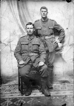 Portrait of William (Bill) Nielsen (standing) and Thomas Denbee, both of 2nd Battalion, New Zealand Rifle Brigade, at Armentieres, June 1916. Image courtesy of Wairarapa100. Image has no known copyright restrictions.