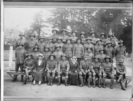 Maori Pioneer Battalion; reinforcements, Wanganui and West Coast (North Island) Platoons - Photographer unidentified. From left to right, Back row: N Taiaroa, H Tanguru, N Potaka, R Tamakehu, H Erueti, D Te Huna, K Te Huia. Third row: Kahukura, T Hiri, P Timoti, Rangi (the bugler), W Rangitauira, C Tawhati, D Tonihi, P Haami, Tom Kingi, R Wheato, T Kaiwhare.Second row: W Taputoro, K Huirua, R Marumaru, T Te Hina, P Katene, A Phillips. Seated: Rangi Pokiha, Pirihira Kingi, R Tapa, R Tuatini, Mrs Tuatini, Lieutenant H Omana, Sergeant J Omana, B Stubbins, Hori Tinirau. Image kindly provided by Alexander Turnbull Library Ref: 1/1-021303-G.No known copyright restrcitions.