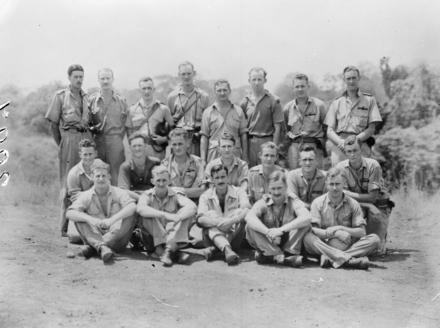 Group of No. 3 Squadron aircrew. Guadalcanal. L- R: Back; Flying Officers A. McD Stevenson, J. F. Gabites, J. J. McDowell, W. J. S. Monks, Flight Lieutenants A. C. Allen, W. R. B. Watson, Flying Officers J. Coom, L. Hood. Middle: Flying Officers R. M. McKechnie, A. N. Arnott, H. C. Carter, B. E. Malone, Flight Lieutenant E. A. Barker, Flying Officers J. S. Knobloch, R. J. Alford. Front: Flying Officers R. W. Walker, G. E. Gudsell, W. D. H. Smith, A. B. Horrocks, S. D. Walker. Kindly provided by the Air Force Museum of New Zealand