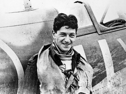 Portrait of 'Johnny Houlton standing beside a No. 485 Squadron [?]. Unknown location.' Air Force Museum of New Zealand, Ak838-94. CC BY-ND 3.0 NZ.