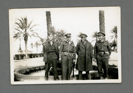 "Photograph of Trevor James Arnold, with Captain Barnett, Lieutenant Chapman and Warrant Officer Johnston. 'I was contemplating to grow a ""mow"" for a while.' Image kindly provided by Faye Brea (November 2020)."