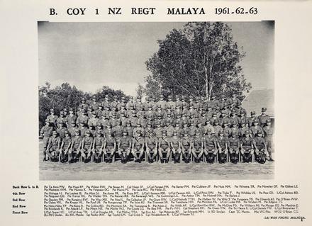 B. Coy 1 NZ REGT MALAYA 1961-62-63. Back Row L. to R. Pte TeAmo PW. Pte Hapi RP. Pte Wilson RW. Pte Bevan M. Cpl Noon SF. L/Cpl Pangari PM. Pte Barrar FM. Pte Culshaw JF. Pte Nuix MM. Pte Wineera TR. Pte Moverley CP. Pte .Gibbes LE. Pte Mathews WM. Pte Hamon K. Pte Ferguson DG. Pte Harris PS. Pte Lane RG. Pte Heise JS. 4th Row: Pte Hohepa H. Pte Lockett IB. Pte Allott SJ. Pte Jones PR. Pte Kopa MT. L/Cpl Hemana MK. L/Cpl Pawson AD. L/Cpl Pirini DW. Pte Tioke T. Pte Whibley JS. Pte Peat GD. L/Cpl Ashton BD. Pte Ferguson CD. Pte Turner RC. Pte Walker TN. Pte Renney RB. Pte Kavanagh WS. Pte Curnmings LC. Pte Arthur TM. Pte Holwell NA. Pte Karipa J. 3rd Row: Pte Deazley PM. Pte Ranginui RW. Pte Way MD. Pte Neal L. Pte Gallagher JP. Pte Grant RW. L/Cpl Nicholls TTH. Pte Halbert W. Pte Wiki Pte Pungatara PB. Pte Edwards AS. Pte O'Brien WW. Pte Oakes WL. Pte Knapp HL. Pte Ryall JB. Pte Rungarunga TP. Pte Scott RJ. Pte Thornton SR. Pte Tamihana HH. Pte Morrison PA. L/Cpl Cooke MR. Pte Walters M. Pte Killgour TS. 2nd Row: Pte Niho Niho TP, Pte Keno R. Pte Collins RD. Pte Morrison EA. Pte Tumataroa B. Pte Aston J. Pte Wells AF. L/Cpl Kiwi Kiwi RW. Pte McGhee PD. Pte Williams Ml. Pte Mauger EG. Pte Matchitt E. Pte Rowlands R. Pte Adank LF. Pte Mears NE. Pte Michie WJ. Pte Coutts LG. Pte Best PM. Pte Pu WH. Cpl Shepherd RH. Pte Owen TW. Pte Te Haara R. L/Cpl Daniels FW. L/Cpl Brosnahan T. Front Row: L/Cpl Grace HC. L/Cpl Avey TA. L/Cpl Douglas AB. Cpl Pilcher TTA. Sgt Don AJ. Sgt Mckenzie RF. Sgt Edwards MH. Lt BD Sinclair. Capt TG Martin. Maj WG Pike. W02 O'Brien CG.2Lt MH Devlin. 2Lt RA. Monks. Sgt Packer AW. Sgt Taylor LM. Cpl Cribb S. Cpl Wedderburn R. L/Cpl Wheeler PJ. LAI WAH PHOTO. MALACCA. Image Image kindly provided by Bill Russell, Vice President of the Malayan Veterans Association (December 2020).