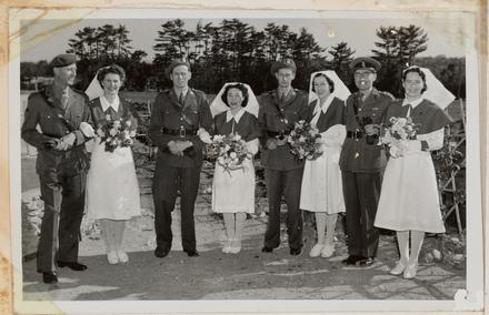 Wedding portrait of Captain Mayne Smeeton and Sister Clementina MacDonald, outside 6 New Zealand General Hospital, Kiwa Japan. L to R: Maj. D. McGavin, Sister Foot, Capt. W.M. Smeeton, Charge Sister Tina MacDonald, Lt. S. Beresford, Sister Pat Lousley, Col. G. Burne and Matron C. McDonald. Auckland Museum PH-ALB-398-p14-4