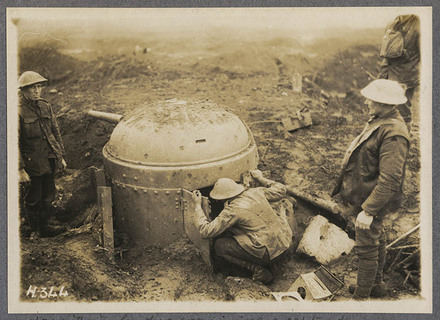 New Zealanders examining a captured anti-tank gun. 3rd N.Z.R.B. Clapham Junction.
