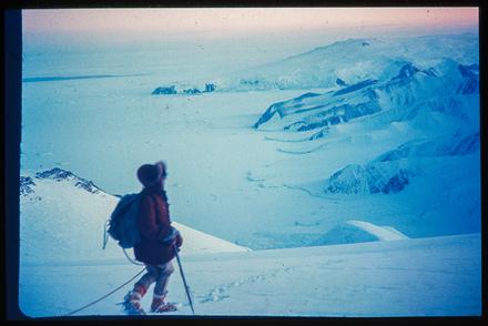 [Climber overlooking Antarctic landscape]