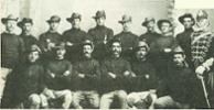 From left, in front: Arthur W Gannon # 1518; John  Davidson # 1377; George Bougen # 1381, John Walker # 1375 Lt Beckham Arthur # 1383 James Langham # 1386 Cpt Winter    Back row: Fred Peakman # 1387; Francis Burch # 1379; Josiah Whitehead # 1374; Frederick Barton # 1384; David Bruce # 1385; Francis Fraser # 1376; John Rogers # 1504; Francis Sharp # 1378; Francis Bruce # 1382 - No known copyright restrictions.