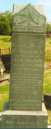Family grave memorial, Waikaraka Public Cemetery (photo Paul F. Baker). Note: Another J Thompson, with the NZ Rifle Brigade, was killed the same day. However, John Thompson served in the same Auckland Infantry Battalion as William Grupen and is assumed to be the one mentioned on the memorial stone. - No known copyright restrictions