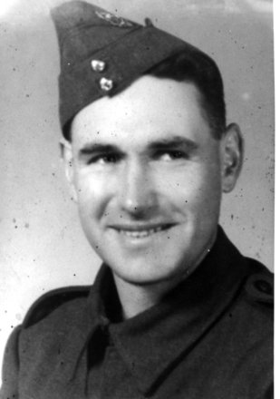 M Baker, portrait, cap - This image may be subject to copyright