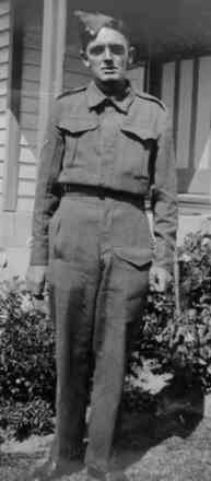 Portrait, standing in uniform in the garden (kindly provided by family) - This image may be subject to copyright