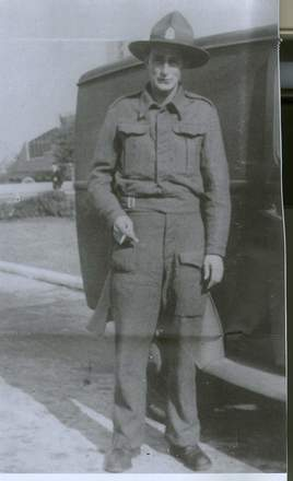 Portrait, standing in uniform beside a car - This image may be subject to copyright