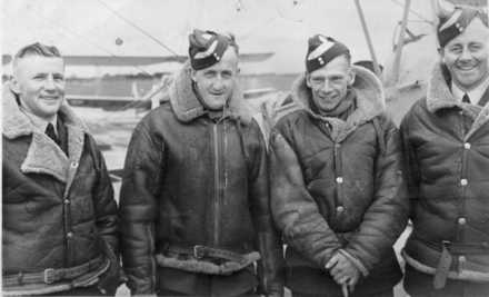 Photo Left to Right LACs Clarry Brittain, Ernie Atkinson, Noel Baty, Bill Bird at No 3 Elementary Flying School (EFTS) Harewood, Christchurch in the winter of 1942. - This image may be subject to copyright