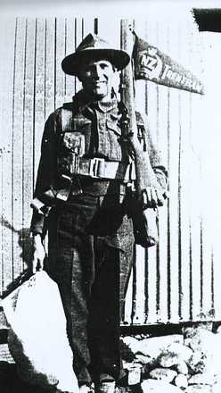 Portrait standing with kitbag, Trentham pennant flying from his rifle (scanned from a photocopied photograph) - This image may be subject to copyright