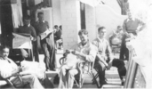 Group, WW2, New Zealand General Hospital, 7 soldiers in pyjamas or [convalescent uniform] reading, smoking, Mo Mitchell (36256) seated, centre - This image may be subject to copyright