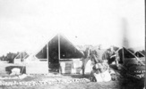 """Isolation Camp, WW1, group of three soldiers outside tent (front), caption in William Young's handwriting """"Our tent"""" Isolation Camp"""" - No known copyright restrictions"""