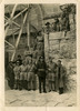 Group of servicemen at Old City Wall, one of the churches held up by huge girders, 7657 Herbert (Roy) Winchcombe (top, 3rd from right) (front) - This image may be subject to copyright