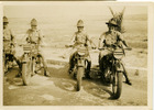 Group, four Despatch drivers on motorcycles, desert, Roy is 2nd on left - This image may be subject to copyright