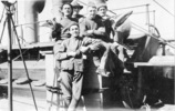 """Troopship, Athenic 1917, Group on deck, 5 men, man standing in foreground on board Athenic 1917Caption """" Div Sign"""". William Young seated with arms crossed. - No known copyright restrictions"""