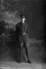 Full length portrait of Rifleman Glen Blair Reg No 26541 of the 17th Reinforcements, 8th Reinforcements to the 4th Battalion - H Company, New Zealand Rifle Brigade. (Photographer: Herman Schmidt, 1916). Sir George Grey Special Collections, Auckland Libraries, 31-B1858. No known copyright.