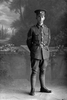 Full length portrait of Corporal (later Sergeant) Thomas Murdy Ball, Reg No 46223, New Zealand Engineers Tunnelling Company, 5th Reinforcements. (Photographer: Herman Schmidt, 1917). Sir George Grey Special Collections, Auckland Libraries, 31-B2670. No known copyright.