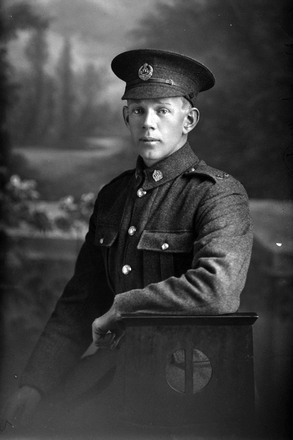 3/4 portrait of Private Charles Kenneth Davidson, Reg No 21225, of the Auckland Infantry Battalion, - A Company, 16th Reinforcements. Killed in action in France on 7 June 1917. (Photographer: Herman Schmidt, 1916). Sir George Grey Special Collections, Auckland Libraries, 31-D1544. No known copyright.