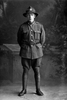 Full length portrait of Private Charles Kenneth Davidson, Reg No 21225, of the Auckland Infantry Battalion, - A Company, 16th Reinforcements. Killed in action in France on 7 June 1917. (Photographer: Herman Schmidt, 1916). Sir George Grey Special Collections, Auckland Libraries, 31-D1545. No known copyright.