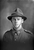 1/4 portrait of Rifleman Norman Warren, Reg No 24/1850, of the New Zealand Rifle Brigade, 2nd Battalion, - F Company. (No F Company in the 9th Reinforcements.) (Photographer: Herman Schmidt, 1915|1916). Sir George Grey Special Collections, Auckland Libraries, 31-W1282. No known copyright.