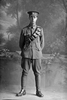 Full length portrait of Sapper Wilson with the New Zealand Engineers, New Zealand Signal Corps, probably Sapper Frank William Wiltshire, Reg No 12687. Killed in action in France on 10 June 1917 at the Battle of Messines. (Photographer: Herman Schmidt, 1916). Sir George Grey Special Collections, Auckland Libraries, 31-W1377. No known copyright.